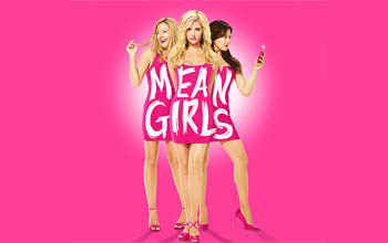 "Mean Girls - Three girls in pink dresses and pink stilettos stand together so that the middle girl is forward and the other two are slightly behind her. The front girl is blond with curled hair staring straight forward. The girl behind her to the left has straight blonde hair and is giggling looking away. The girl behind her on the right has black hair and is staring at her cell phone in her hand. They have the title ""Mean Girls"" written over their dresses."